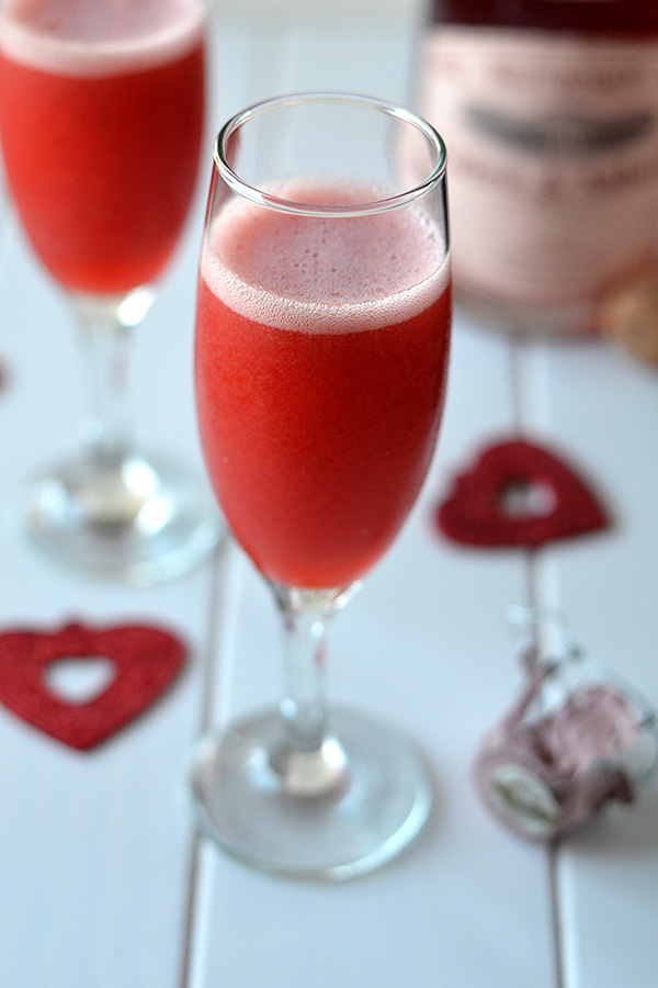 Strawberry Bellini - This Strawberry Bellini is the ultimate holiday cocktail! Two simple ingredients combine for a refreshing sparkly drink to make your holiday complete.