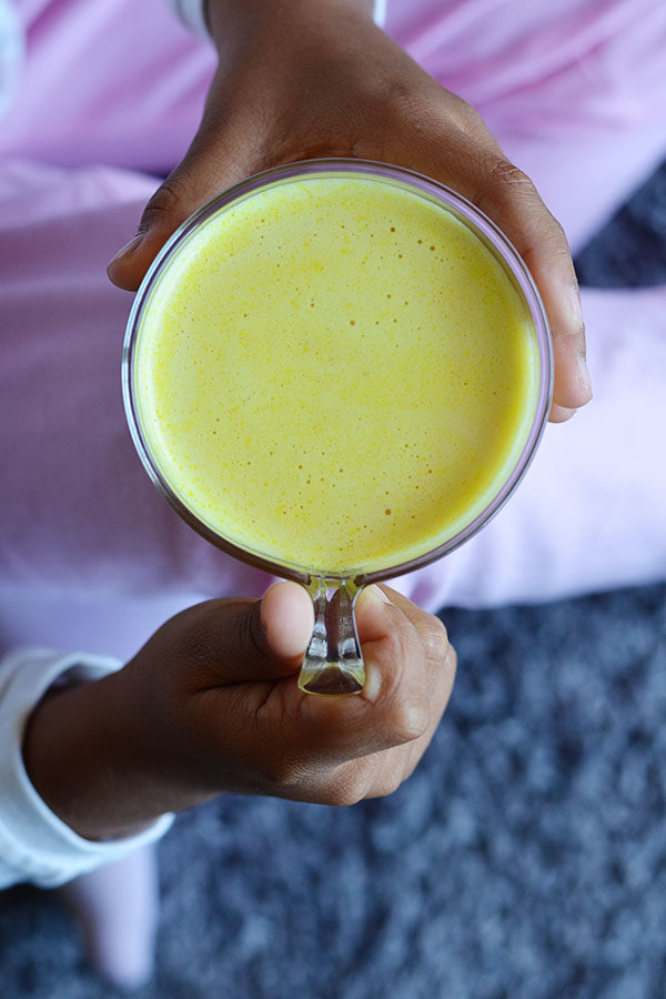 Golden Milk Elixir - Golden milk is an ancient ayurvedic remedy that boosts your immune system helping to combat colds, cough, inflammation, joint pain and so much more. It's so delicious even your kids will ask for more!
