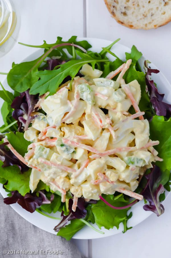 overhead view of greek yogurt egg salad on a bed of greens.