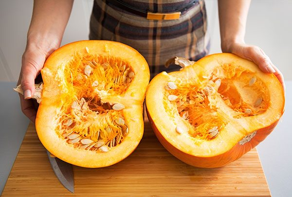 front view of large pumpkin sliced into halves